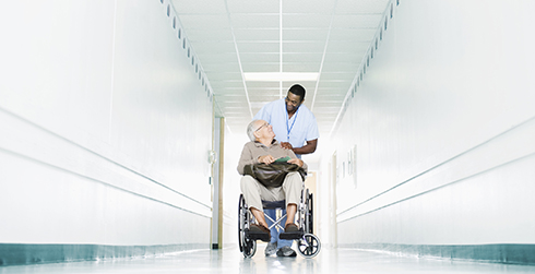 Man wheeled in wheelchair