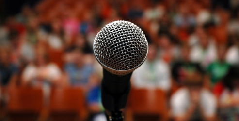A microphone in front of an audience.