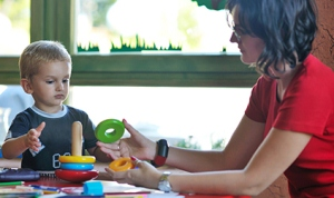 An OT working with a child.